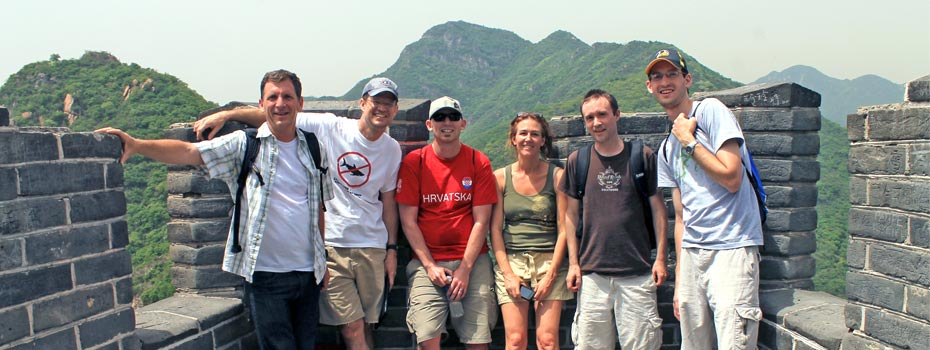 Auctiva staff members visit the Great Wall of China.